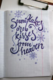 Snowflakes are Kisses from Heaven calligraphic background Stock Image