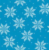Snowflakes on knitted background Stock Photos
