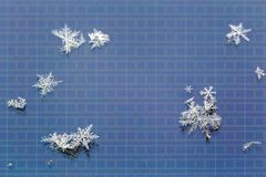 Snowflakes on LCD screen of mobile phone macro background.  royalty free stock photo