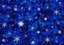 Snowflakes on night sky Stock Images