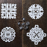 Snowflakes out of paper on wood background Stock Photos
