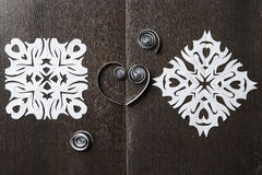 Snowflakes out of paper on wood background Stock Photography