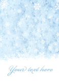 Snowflakes over blue snow Royalty Free Stock Image