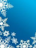 Snowflakes på blue Arkivbilder
