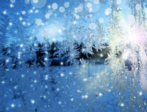 Snowflakes pattern as winter texture background. Snowflakes ice pattern with sunlight on winter window glass royalty free stock images