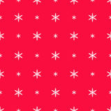 Snowflakes in polka dot pattern on red Stock Images