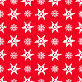 Snowflakes on a red background Stock Photography