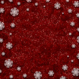 Snowflakes on red glitter background. Snowflakes on a red glittery background Royalty Free Stock Photography