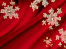 Snowflakes on red velvet background Royalty Free Stock Images