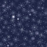 Snowflakes seamless background on dark blue. Seamless  illustration of snowflakes on dark blue background Royalty Free Stock Photography