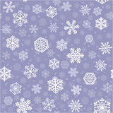 Snowflakes seamless background. Snowflakes of nine kinds arranged on bluish gray. Square tile of seamless background Royalty Free Stock Images