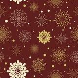 Snowflakes seamless pattern. Golden snowflakes on a red background. Snowflakes seamless pattern. Golden snowflakes on a dark red background Royalty Free Stock Photo