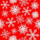 Snowflakes seamless pattern in red Stock Images