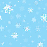 Snowflakes Seamless Pattern. Seamless, repeating pattern of white snowflakes on a blue background Stock Illustration