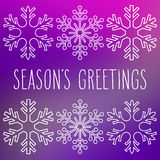 Snowflakes and Season`s Greetings. White snowflakes over square abstract smooth blur background with hand written season`s greetings Stock Photos