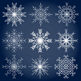 Snowflakes. Set of nine snowflakes on a blue background Royalty Free Stock Image