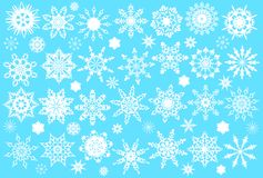 Snowflakes. Set of white snowflakes on a blue background royalty free illustration