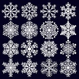 Snowflakes Set. White winter elements for design on dark blue background. Stock Images