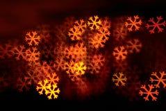 Snowflakes shape lights background. On black stock photo