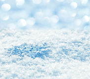 Snowflakes on snow Stock Images
