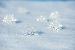 Snowflakes on snow Royalty Free Stock Photos