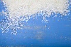 Snowflakes and snow on a blue background Stock Photo