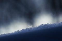 Snowflakes on a snow cover, closeup Stock Photos