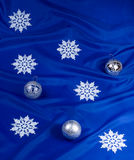 Snowflakes and spheres. On a dark blue background Stock Image