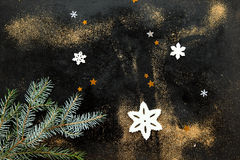Snowflakes, Stars and Fir Stem on Black with Dust. Snowflakes, Stars and Fir Stem Against Black Background with Scattered Gold Dust Stock Photos
