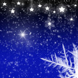 Snowflakes, stars and ice crystals. Snowflakes and ice crystals in a night sky with shining stars and stardust Royalty Free Stock Photos