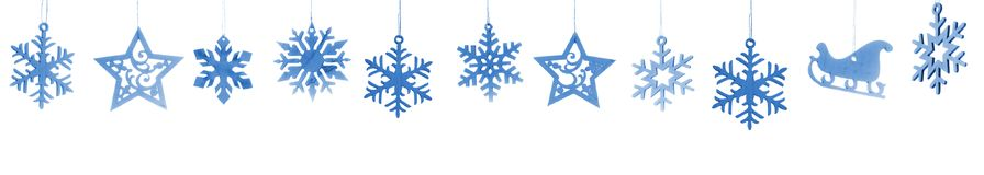 Snowflakes and stars isolated on white background. Wooden snowflakes and stars isolated on white background stock image