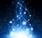 Snowflakes and stars shining descending on blue Royalty Free Stock Photos