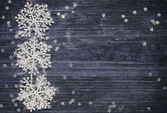 Snowflakes and stars on wooden background Royalty Free Stock Images