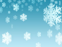 Snowflakes (style 2). Snowflakes in falling from the blue sky Royalty Free Stock Photos