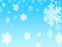 Snowflakes (style 4). Snowflakes in falling from the blue sky Royalty Free Stock Photo