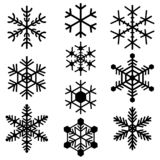 Snowflakes symbols icons signs logos simple black colored set vector illustration