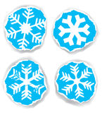 Snowflakes on the torn paper Royalty Free Stock Photo