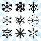 Snowflakes variations vector art. Black simple style Royalty Free Stock Image