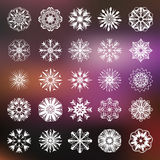 25 snowflakes vector collection. Snowflakes icons collection on blurred background. New Year and Christmas concept.  Modern design of snowfall elements. Vector Stock Photography