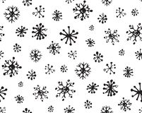 Snowflakes. Vector illustration. Cute eve natal icy asterisk pictogram template of nativity holiday design on light blue sky backdrop. Freehand outline black ink Royalty Free Stock Images