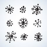 Snowflakes. Vector illustration. Cute eve natal icy asterisk pictogram template of nativity holiday design on light blue sky backdrop. Freehand outline black ink royalty free illustration
