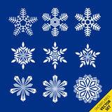 Snowflakes vector set. Snowflakes isolated on a blue background. Set of 6 different snowflakes Royalty Free Stock Photography
