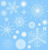 Snowflakes vector set in white and blue. Royalty Free Stock Image