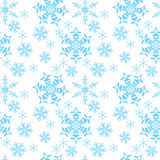 Snowflakes on a white background. Blue snowflakes on white background Stock Photography