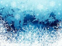 Snowflakes on window Stock Photography