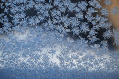 Snowflakes at the window in the winter Stock Image