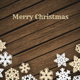 Snowflakes on wood background Stock Image