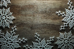 Snowflakes on wood. Snowflakes on a wooden background stock images