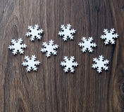 Snowflakes. On the wooden background royalty free stock images