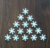 Snowflakes. On the wooden background stock images